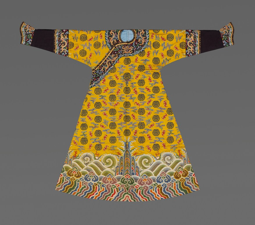 yellow dress with elaborate embroidered decoration
