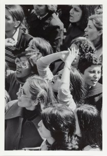 Black and white photo of a woman in a crowd