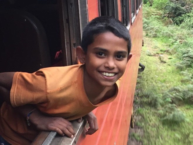 A photo of a child leaning out of a train