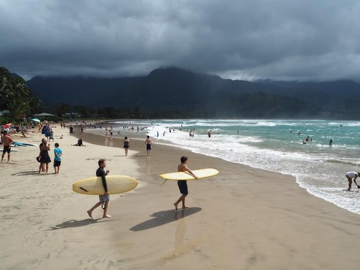 Surfers on Hanalei Bay