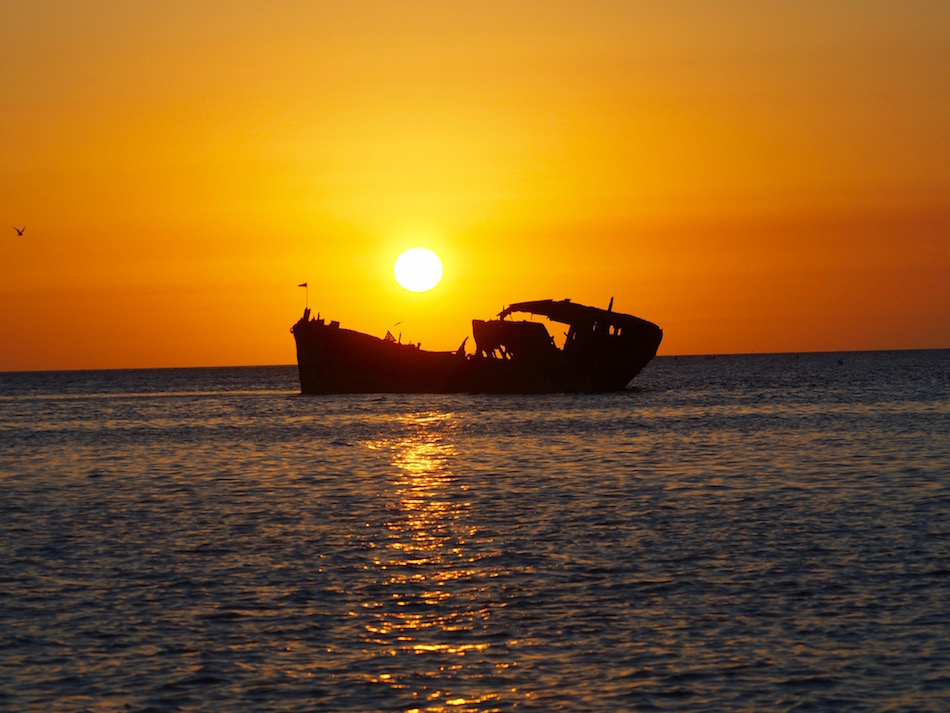 Beautiful sunset over the shipwreck.