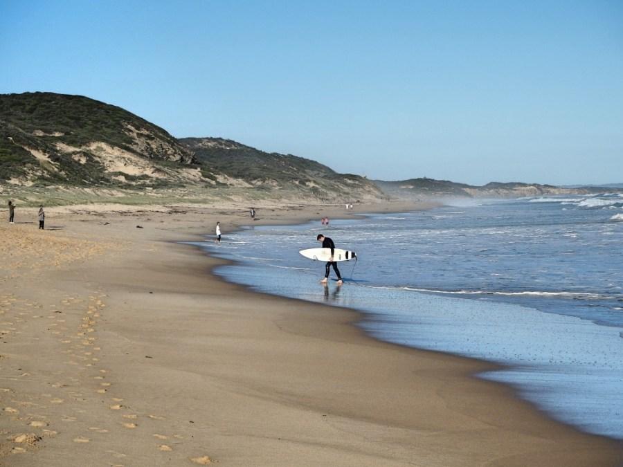 A surfer on Portsea's back beach.