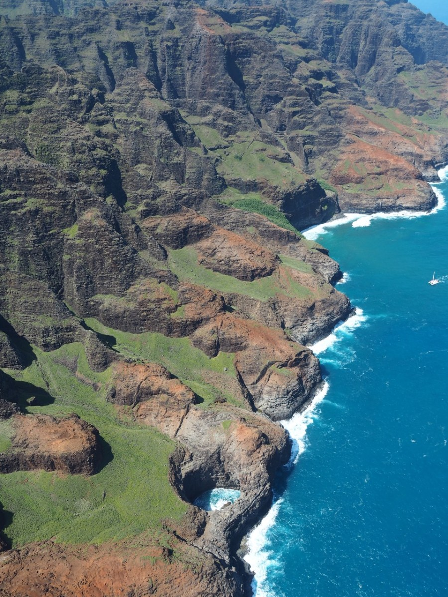 The Na Pali Coast and its open-ceiling sea cave.
