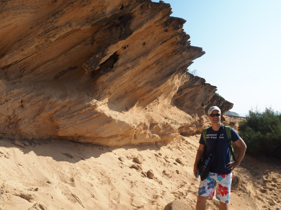 Walking through sand dunes and limestone formations.