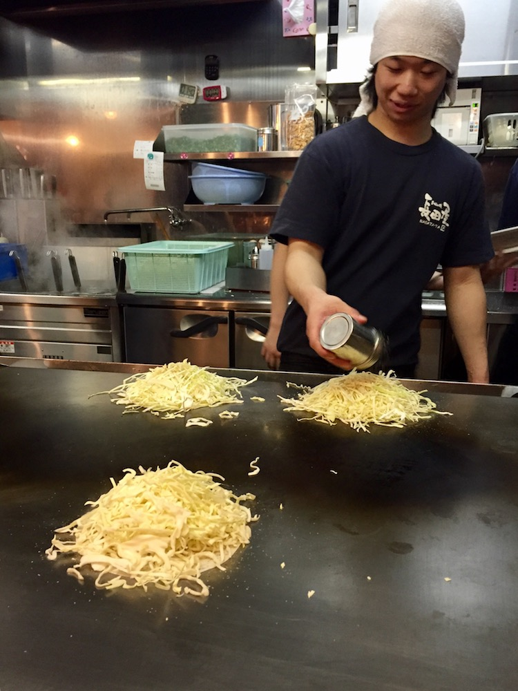 Our Okonimiyaki being cooked!