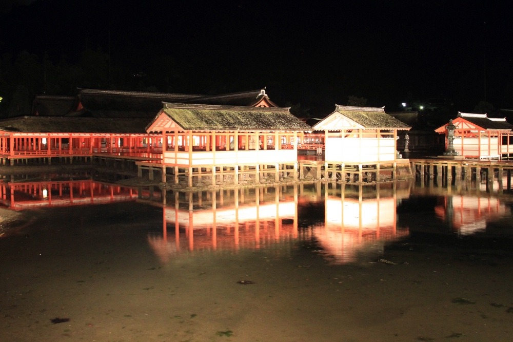 The Itsukushima Shrine at night.