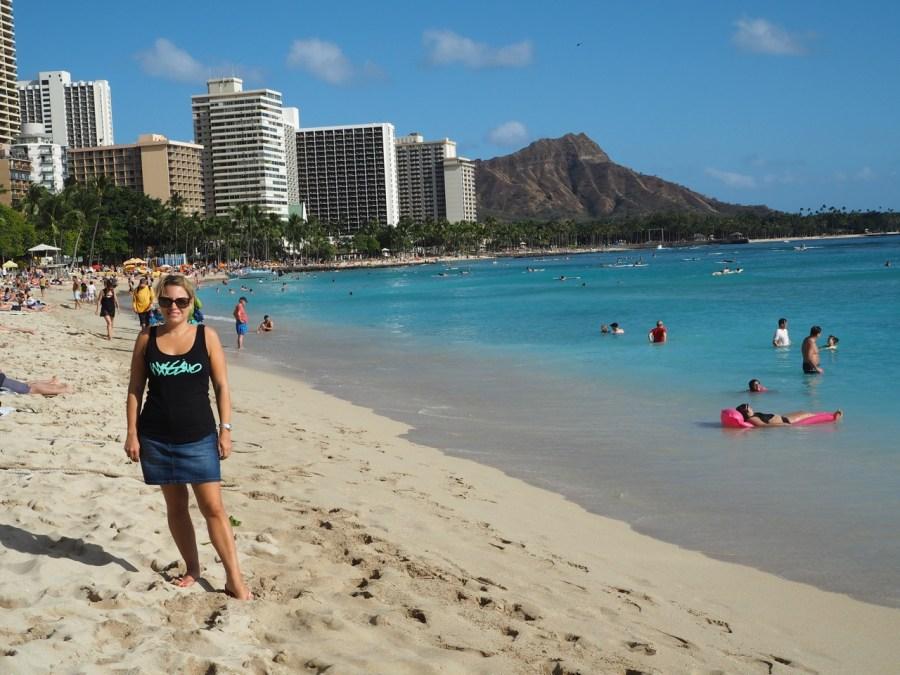 Diamond Head sitting in the background of Waikiki Beach.