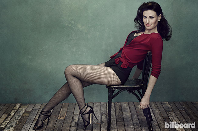 Idina Menzel posing sexy in fishnet stockings..