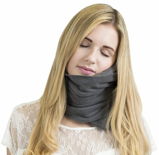 Travel neck pillow supports your neck sleeping in a wheelchair for travel.