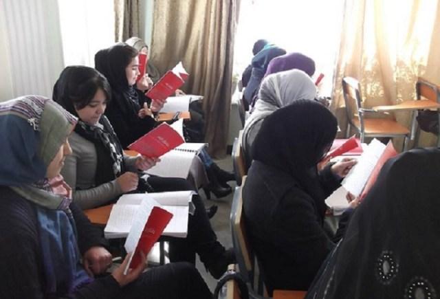Afghan women- reading-writing-
