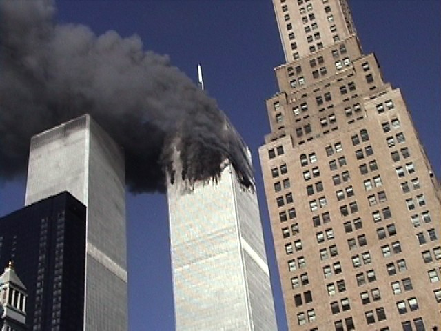 September 11, 2001 - World Trade Center Tower 1 is ablaze. Three seconds before Tower 2 gets hit. (1) Neil deGrasse Tyson