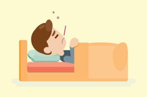 Sick child laying in bed with thermometer in mouth