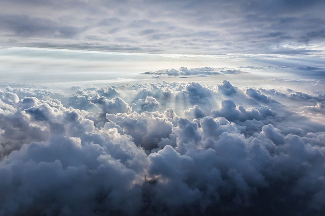 Beautiful blue sky background with abstract clouds