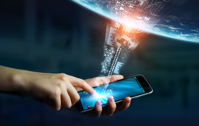 Businesswoman using digital tactile phone to send information to the world