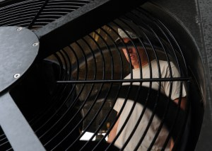 man standing near air conditioner