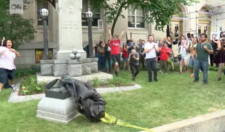 University Of North Carolina Protesters Knock Down Confederate Statue!