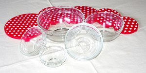 Glass bowls with red spotty lids