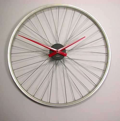 Upcycled bicycle wheel clock from Vyconic