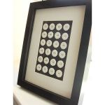 Framed porcelain buttons wall art