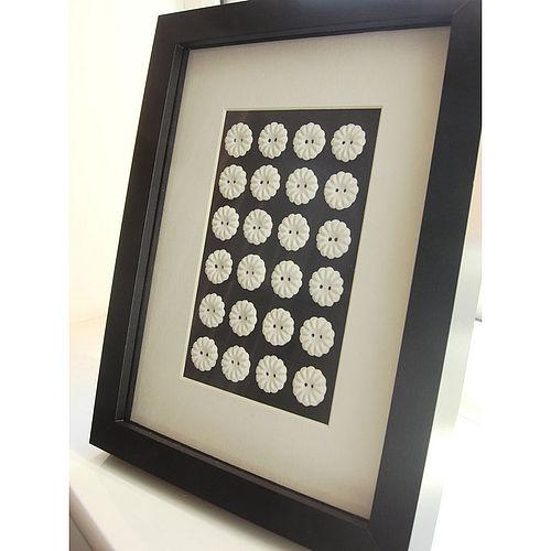 Framed porcelain buttons wall art