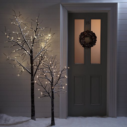Snowy paper prelit xmas tree