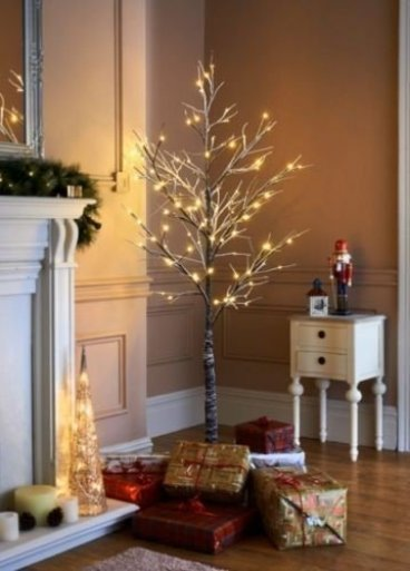 Love this gorgeous 7ft pre-lit snowy twig style Christmas tree. It can be used indoors or out.