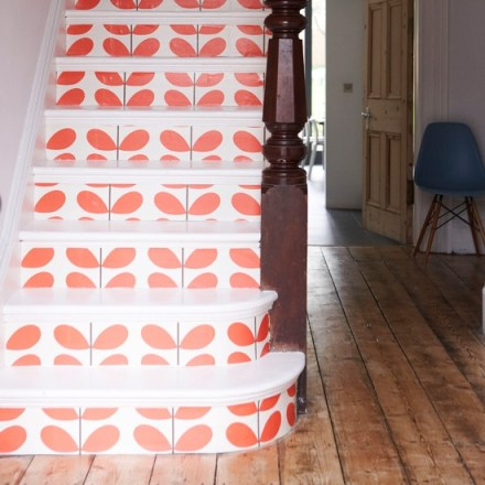 What a fab way to make a statement with your stairs! Love the Orla Kiely design wallpaper.