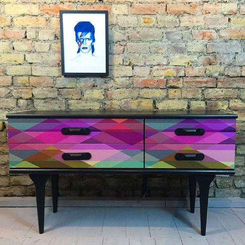 Cole and Son Harlequin Circus wallpaper looks stunning used on this retro sideboard