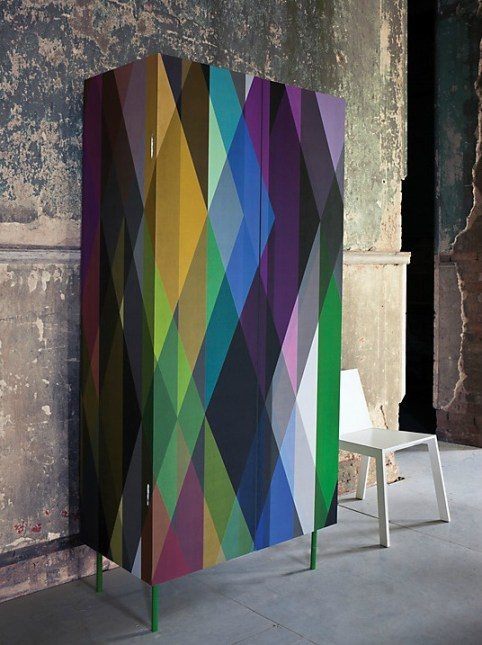 What a stunning wardrobe! The design has been created using Cole & Son's Harlequin Circus wall panel.