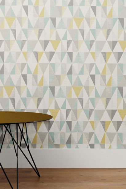 On trend textured geo triangle design wallpaper from Next. Like the slightly weathered look of this one.