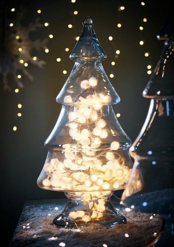 Glass christmas tree jar styled with white snowball lights inside