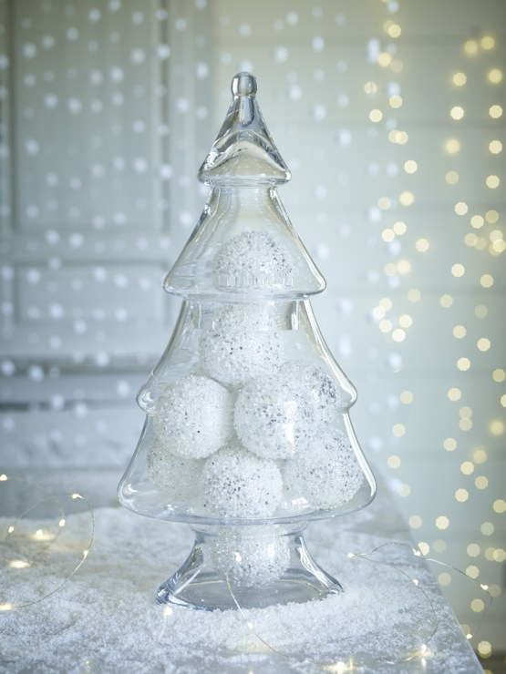 Glass Christmas tree jar filled with white sparkly baubles