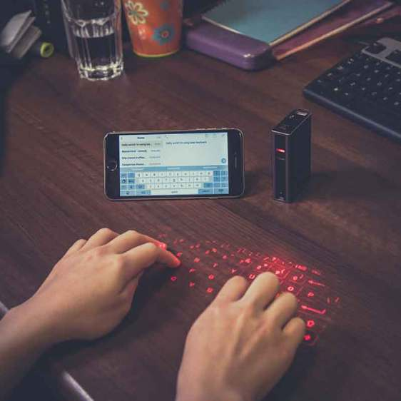 Type on the go with this laser keyboard and power bank