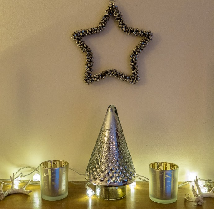 Pretty fireplace Christmas decoration idea with a silver theme