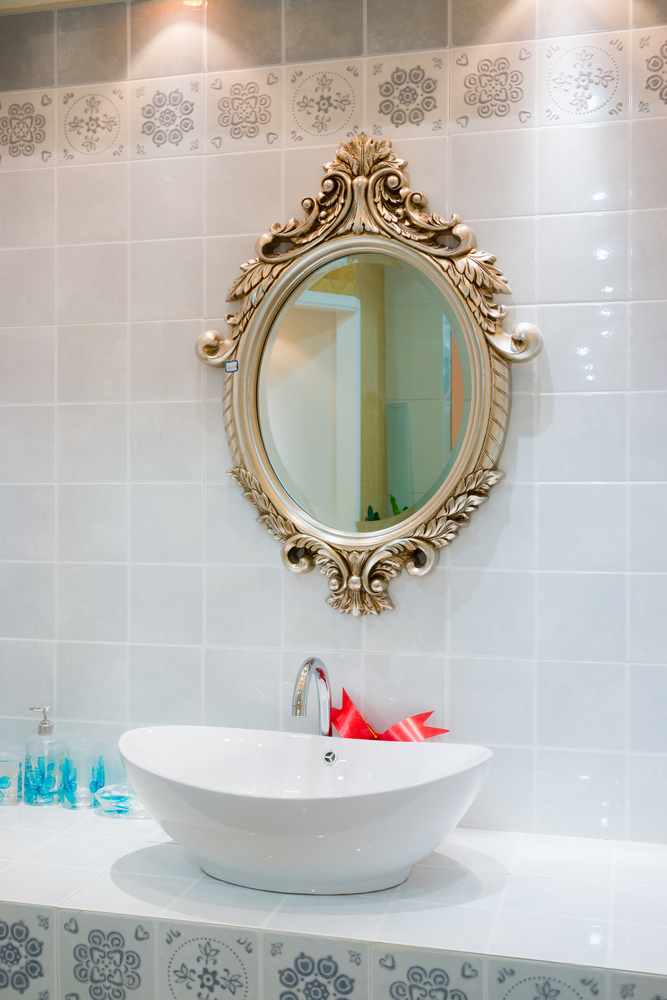 Smarten your bathroom up with an ornate mirror