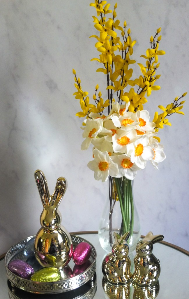 Artificial flowers make for an easy and effective seasonal table decoration