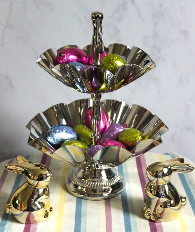 This silver tone two tier cake stand offers a great way to display Easter eggs