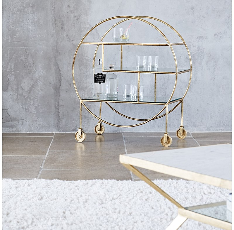 What a stunner this round drinks trolley is! Definitely a piece to serve drinks in style