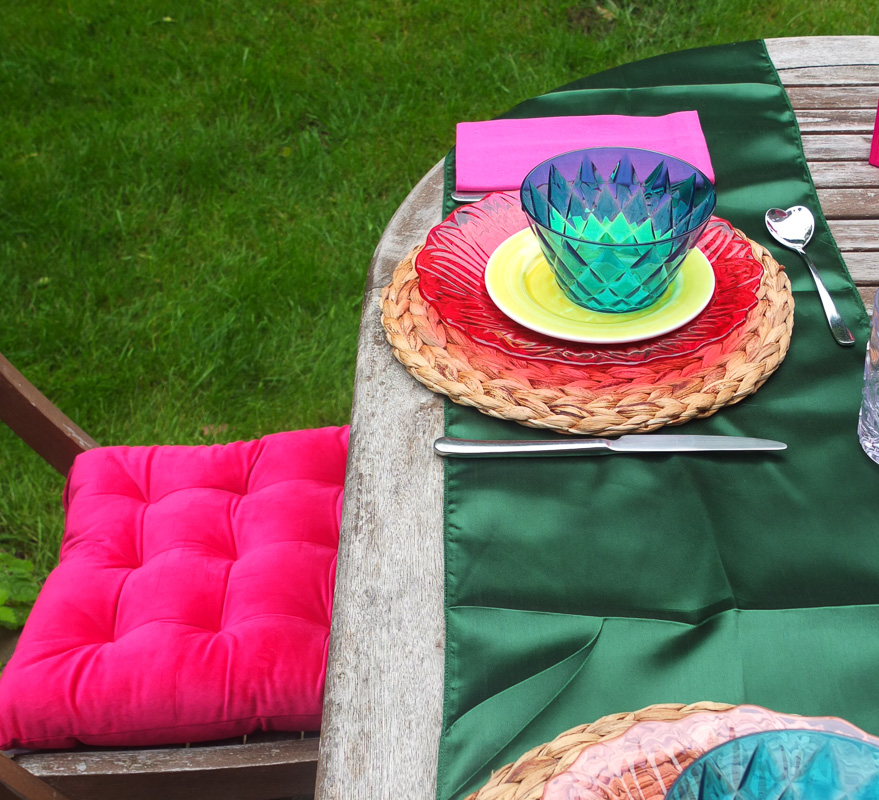 Gorgeous rich pink velvet chair cushions at a luxurious feel to garden chairs.