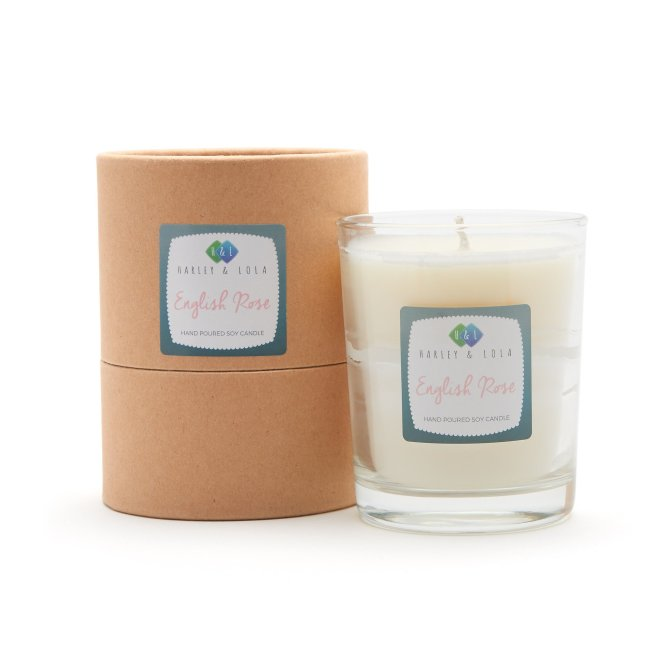 Bring the scent of an English rose garden into your home with this gorgeous scented candle