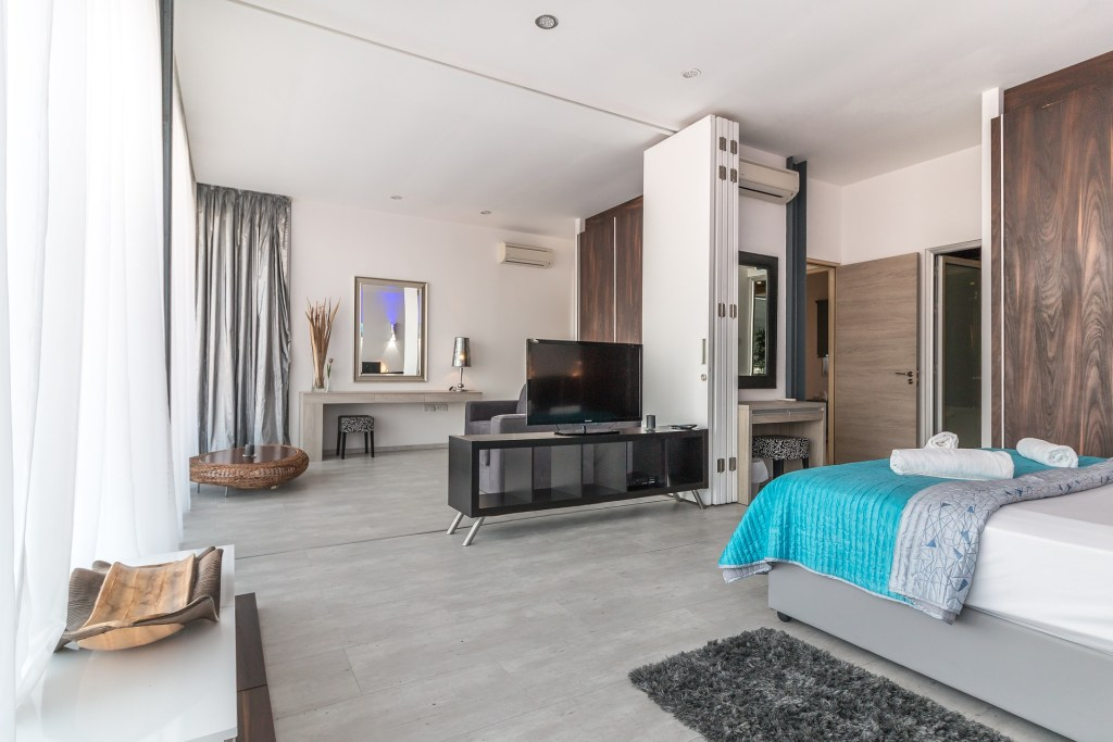Laminate flooring is a great choice for a bedroom floor.