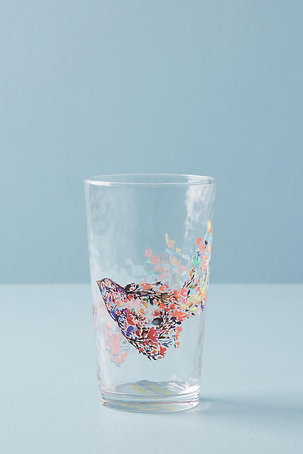 Exclusive juice glass featuring a design by artist Kiana Mosley