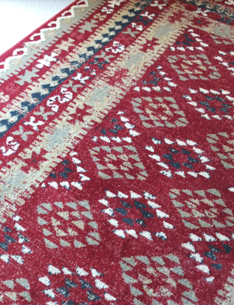 The striking design of the Royal Keshan rug, which incorporates some authentic ethnic and tribal designs