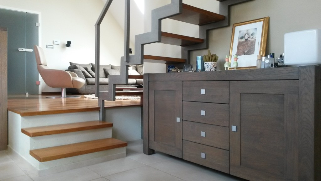 A cabinet can be a useful piece of furniture for storage under the stairs