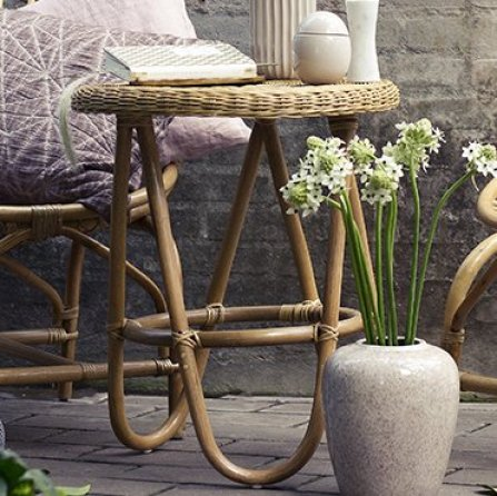 Lovely little rattan side table that can be used inside or out