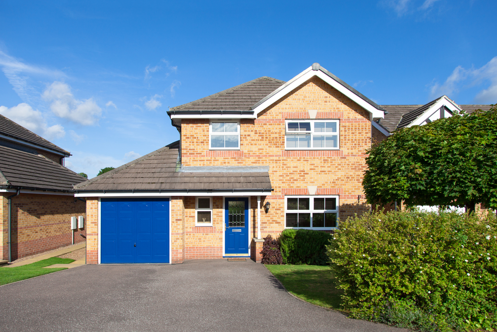 Paint your front door and garage door in a welcoming colour