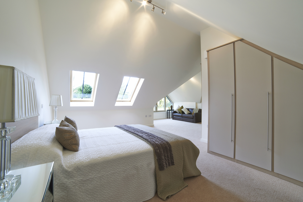 Beautiful calm and light loft bedroom conversion featuring custom build storage option - a nice idea to style a loft conversion