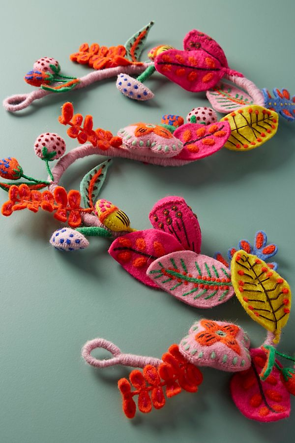 Add this felted wool garland to your Christmas decorations for a pop of colour