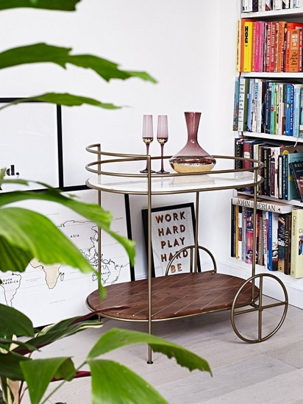 Classic bar cart style drinks trolley made from solid dark acacia wood and marble