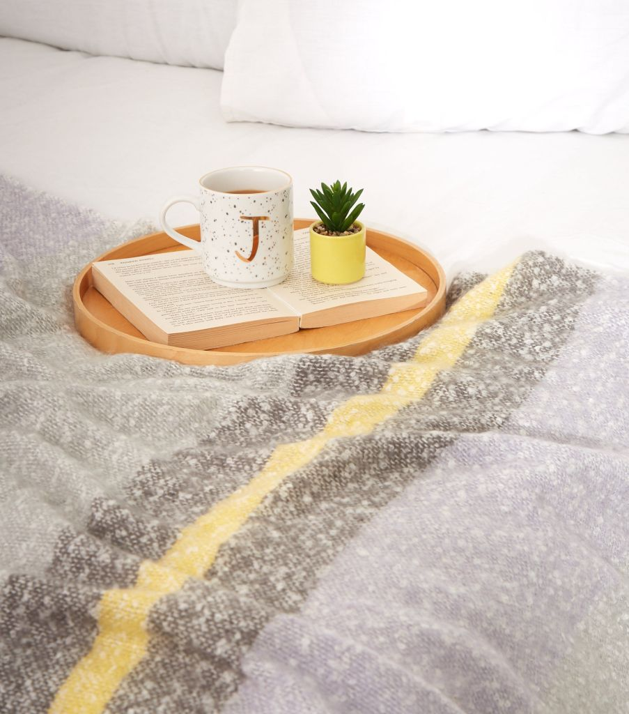 Use this grey pastel block stripe throw on your bed or sofa for an extra cosy layer. It's an affordable homeware idea from New Look, the high street store, so won't break the bank.